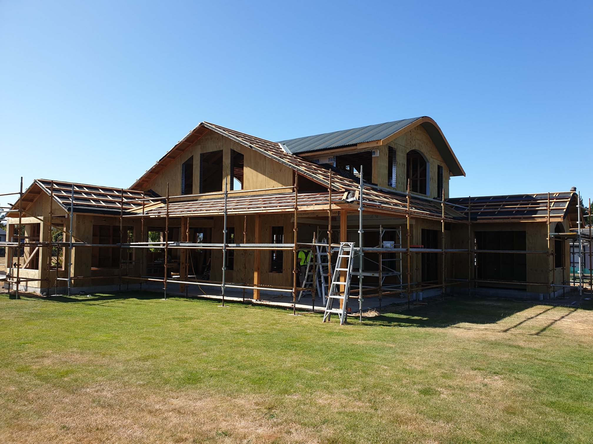 Curved corrugated iron roof installation in Hanmer Springs